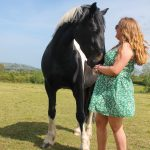 Horse and owner posing